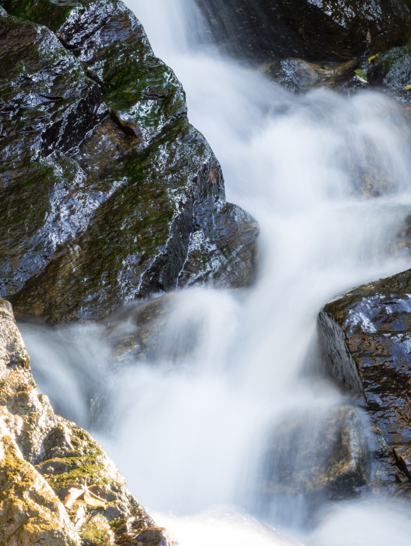 Freshwater flowing around rocks